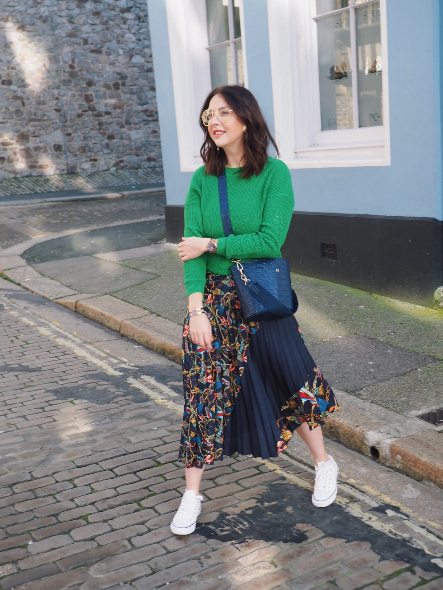 Fashion blogger demonstrates styling ideas for a midi skirt